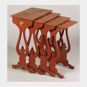 Nest of Four Chinese-style Red Japanned and Parcel Gilt Trestle Stacking Tables
