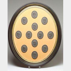 Framed Group of Twelve Wedgwood Black Basalt Portrait Medallions