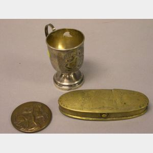 Coin Silver Footed Mug, Michael Lantz Bronze Medal, and an Oval Etched Brass Tobacco   Box