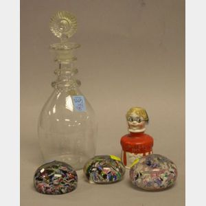 Three Glass Paperweights, a Clear Glass Three-Ring Decanter, and a Carters Ink Ceramic Figural Bottle.