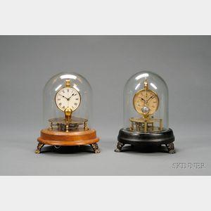 Two Briggs Rotary Pendulum Clocks