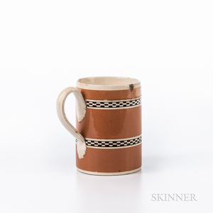 Engine-turned and Slip-decorated Creamware Half-pint Mug