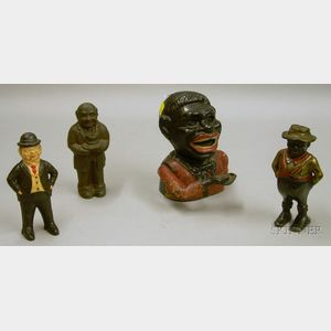 Painted Cast Iron Jolly Nigger Mechanical Bank, a Black Character Still Bank, and Two Man-with-Hat Still Banks....