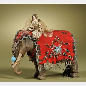 China Doll with Wood Body Riding an Elephant