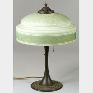 Painted Molded Art Glass and Patinated Cast Metal Table Lamp.