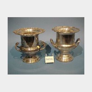 Two Silver Plated Champagne Buckets, Caster Set and a Brass and Wood Wine Tilt.