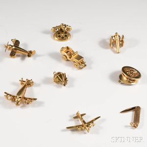 Nine 14kt Gold Militaria-themed Charms
