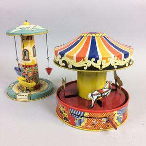 Two Lithographed Tin Wind-up Toy Carousels