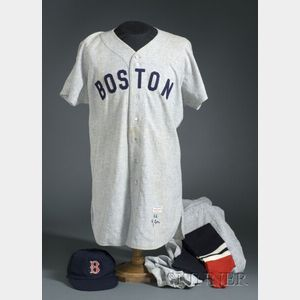 Sold for: $35,250 - 1955 Ted Williams/Boston Red Sox Wool #9 Game Worn Jersey, 1956 Johnny Schmitz/Boston Red Sox Game Worn Pants, with a Cap and Leggings