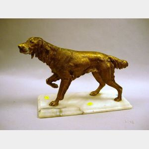 Patinated Cast Metal Retriever Figure on a White Marble Base.