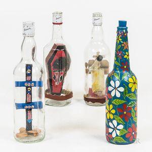 Four Haitian Folk Art Bottles