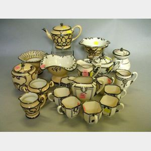 Nineteen Pieces of Silver Overlay Glazed Porcelain Tea and Tableware.