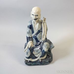 Blue and White Ceramic Figure of a Seated Scholar