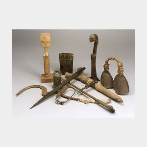 Eleven African Carved Wood or Metal Items