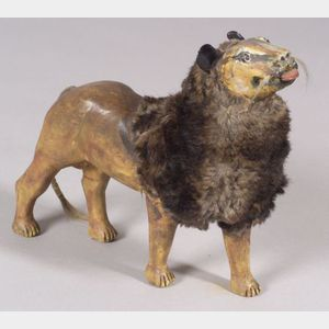 Carved and Painted Wooden Figure of a Lion