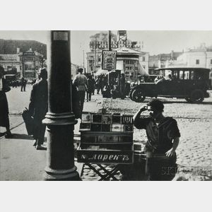 Alexander Rodchenko (Russian, 1891-1956)      The Cigarette Seller, Pushkin Square, Moscow