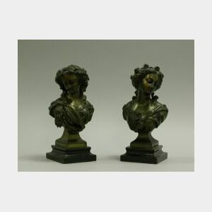 Pair of Patinated Metal Busts of Women