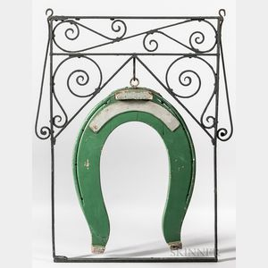 Wrought Iron and Carved and Green-painted Wood Farrier's Trade Sign