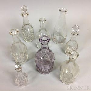 Eight Small Blown Glass Bar Bottles