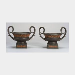 Pair of Wedgwood Black Basalt Crater Urns and Covers