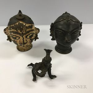 Two Bronze Heads of Gauri and a Bala Krishna Figure