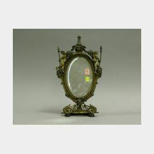 Bronze Framed Beveled Glass Table Mirror with Cherubs.