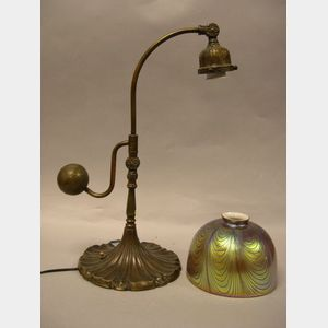 Patinated Cast Bronze Desk Lamp with Favrile Art Glass Shade.
