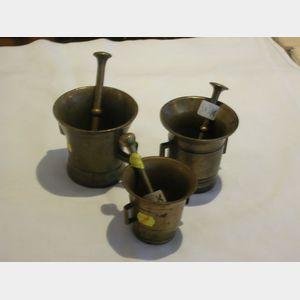 Three Brass Mortars and Pestles