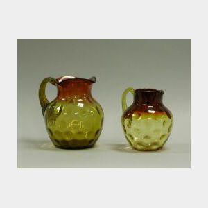 Two Amberina Glass Pitchers.