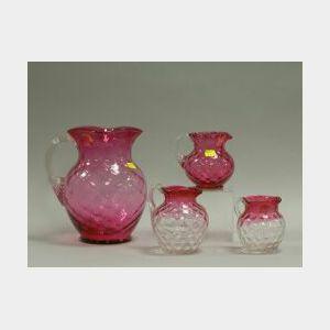 Four Cranberry Glass Pitchers.