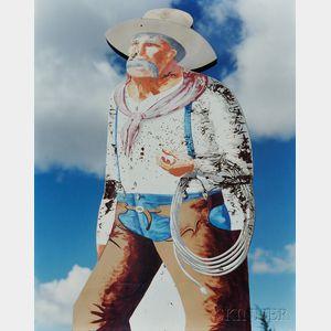 Jim Dow (American, b. 1942)      Cowboy Sign on the Enchanted Highway near Mandan, North Dakota