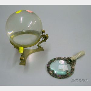 Chinese Hardstone-mounted Silver Magnifying Glass and a Colorless Glass Gazing Ball on Brass Stand.