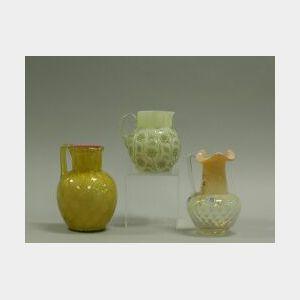 Three Victorian Cased Glass Pitchers