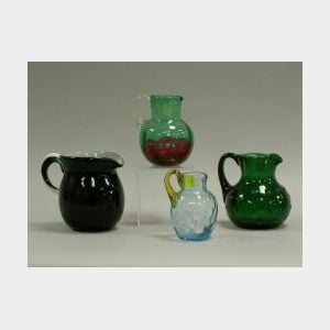 Four Victorian Colored Art Glass Pitchers.