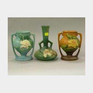 Roseville Pottery Magnolia and Two Water Lily Vases.