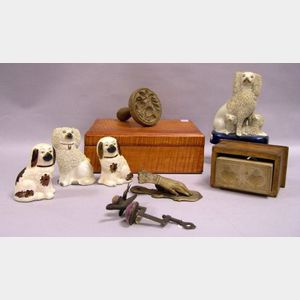 Tiger Maple Document Box, Two Carved Wooden Butter Molds, a Metal Sewing Bird, a Metal Figural Hand Paper Holder, and Four Staffordshir