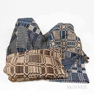 Four Jacquard Blue and White Coverlets and a Brown and White Coverlet