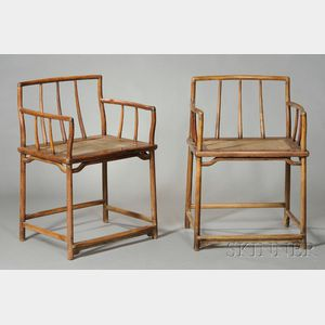 Sold for: $118,500 - Pair of Low-back Huanghuali   Armchairs