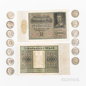 Thirteen Kennedy Half Dollars and Two 1922 German 10,000 Mark Notes