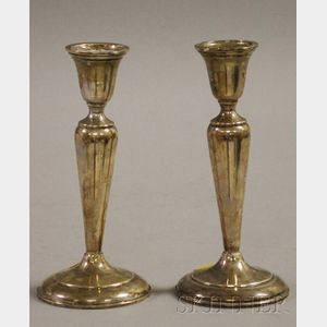 Pair of Cartier Sterling Weighted Candlesticks