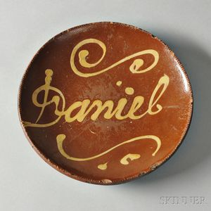 "Redware Plate with Yellow Slip Inscription ""Daniel,"""