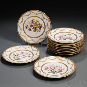 Eleven Hand-painted Limoges Porcelain Plates Depicting Orchids