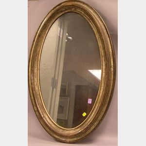 Oval Silver Gilt Molded Wood Mirror.