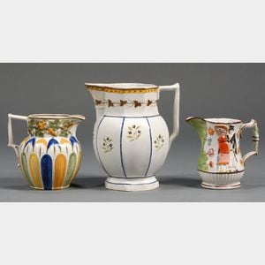 Three Decorated Earthenware Pitchers