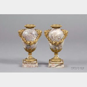 Pair of Louis XVI Ormolu-mounted Marble Candlesticks