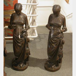Two Matching Bronze Figures of Women