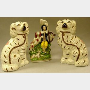 Pair of Staffordshire Spaniels and a Figural Group.