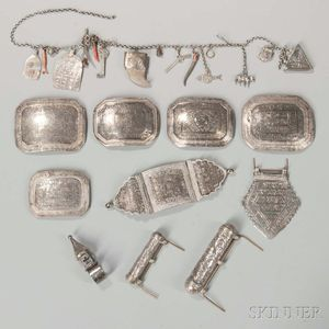 Group of Near Eastern Silver Amulets, Amulet Cases, and a Marriage Ring