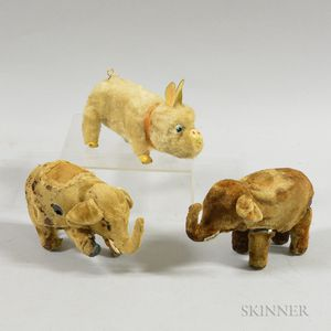 Two Wind-up Mechanical Elephants and a Pig