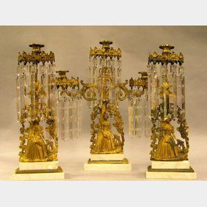 Three-Piece Gilt-metal Figural Girandole with Prisms.